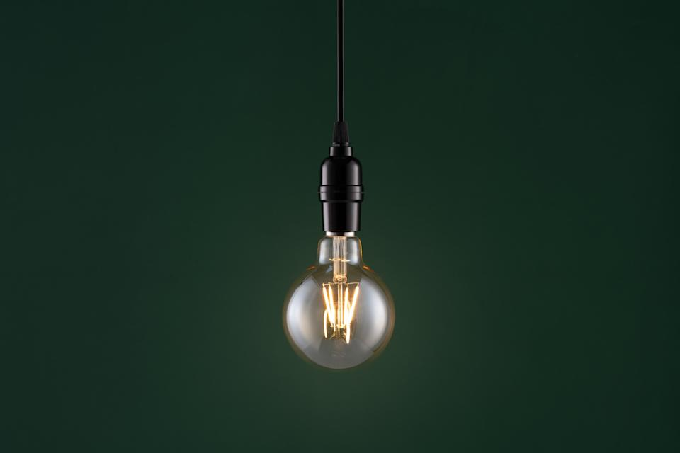 Retro Style Light Bulb on Dark Green Colored Background. Please Note This is a LED Light not Incandescent Light.