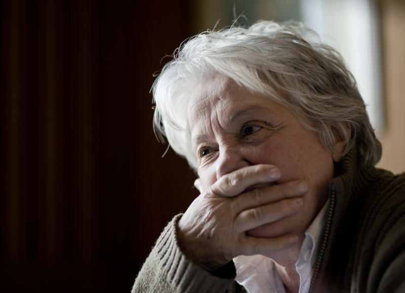 "In this Aug. 26, 2013 photo, first lady and Senator Lucia Topolansky pauses during an interview at her office in Montevideo, Uruguay. As a young woman, a revolutionary, a prisoner and a politician, she said she's always sought ""public happiness."" (AP Photo/Matilde Campodonico)"