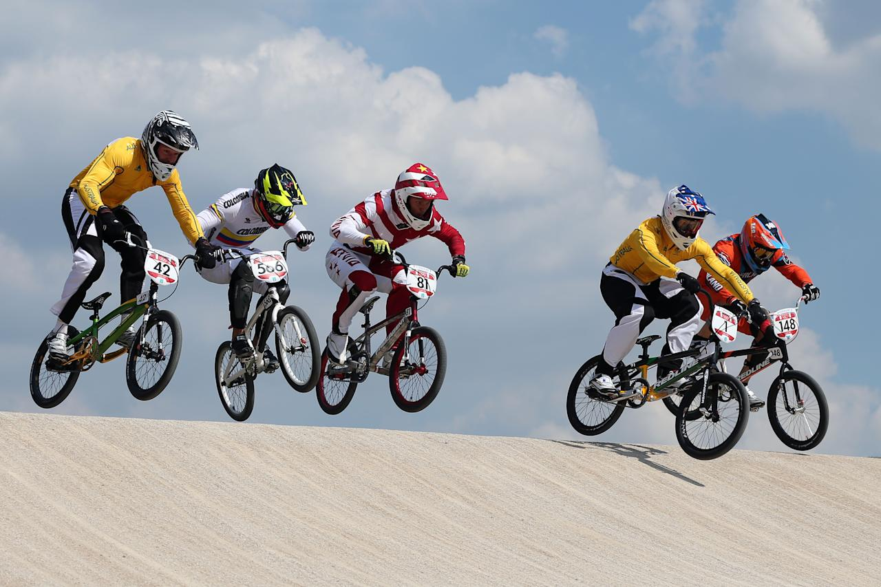 LONDON, ENGLAND - AUGUST 09:  (L-R)  Brian Kirkham of Australia, Carlos Mario Oquendo Zabala of Colombia, Maris Strombergs of Latvia, Sam Willoughby of Australia and Twan van Gendt of the Netherlands clear a jump during the Men's BMX Cycling Quarter Finals on Day 13 of the London 2012 Olympic Games at BMX Track on August 9, 2012 in London, England.  (Photo by Bryn Lennon/Getty Images)