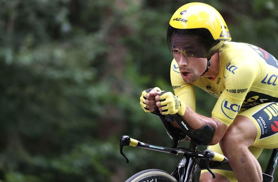 Team Jumbo rider Slovenias Primoz Roglic wearing the overall leaders yellow jersey rides during the 20th stage of the 107th edition of the Tour de France cycling race a time trial of 36 km between Lure and La Planche des Belles Filles on September 19 2020 Photo by KENZO TRIBOUILLARD  AFP Photo by KENZO TRIBOUILLARDAFP via Getty Images