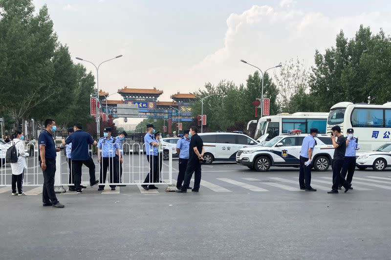 Beijing steps up coronavirus measures as dozens of cases emerge from a food market