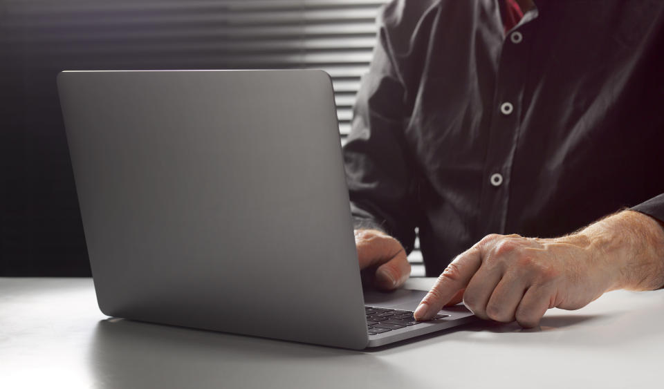 A man at his laptop. (PHOTO: Getty Images)
