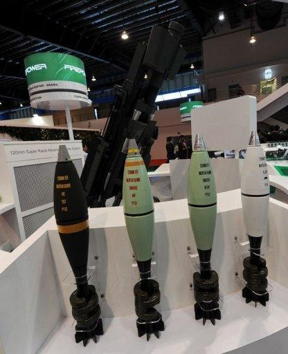 Various type of 120mm ER mortar bombs manufactured by ST Kinetics displayed at the Singapore Airshow in February 2012. Singapore, better known for its clean-cut image and electronics exports, is seeking a place in the global arms industry by exploiting technological expertise honed on its own amply funded military