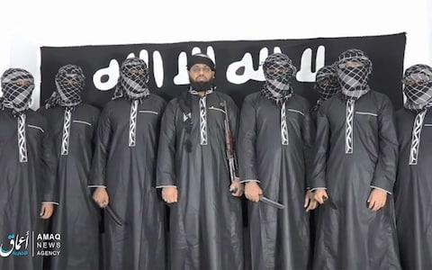 A group of men claiming to be the the Sri Lanka bomb attackers appear in an Isil propaganda video - Credit: Twitter