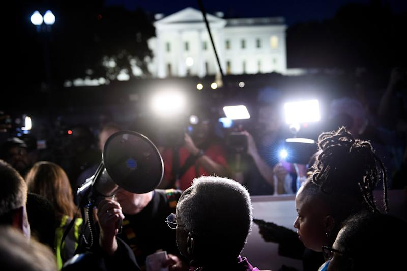 Bishop Michael Curry (C) waits to speak during a vigil outside the White House on May 24, 2018 in Washington, D.C. (BRENDAN SMIALOWSKI via Getty Images)