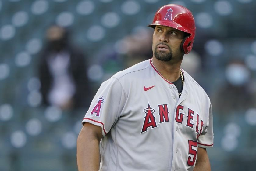 Los Angeles Angels' Albert Pujols walks to the dugout during a baseball game against the Seattle Mariners.