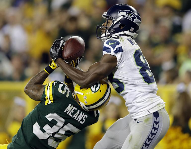 Seattle Seahawks' Stephen Williams (83) catches a touchdown pass over Green Bay Packers' Loyce Means during the second half of an NFL preseason football game Friday, Aug. 23, 2013, in Green Bay, Wis. (AP Photo/Tom Lynn)