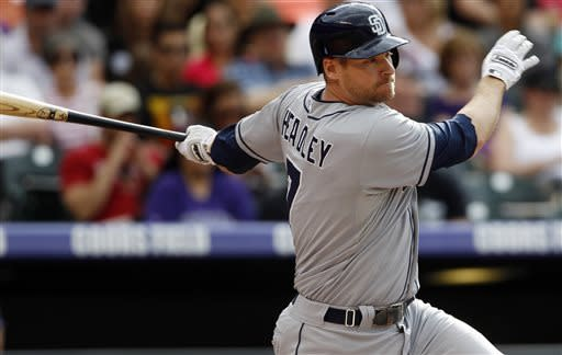 San Diego Padres' Chase Headley follows the flight of his RBI-single against the Colorado Rockies in the first inning of a baseball game in Denver, Saturday, June 8, 2013. (AP Photo/David Zalubowski)