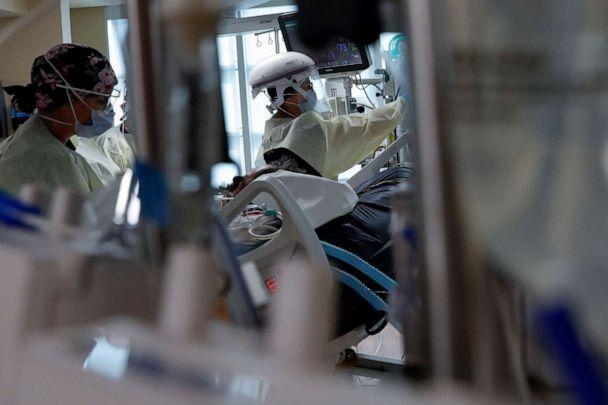 PHOTO: Critical Care Respiratory therapist Lauren Parsons treats a patient in their isolation room on the intensive care unit (ICU) at Sarasota Memorial Hospital in Sarasota, Florida, Sept. 22, 2021. (Shannon Stapleton/Reuters)