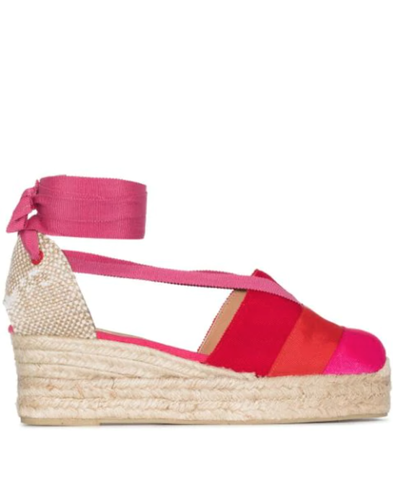 Castañer ribbon tie 50mm wedge espadrilles. Image via Farfetch.