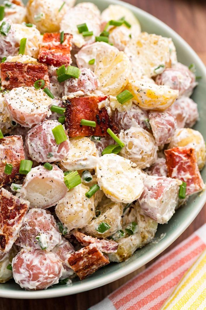 """<p>Bacon and ranch make everything better.</p><p>Get the recipe from <a href=""""https://www.delish.com/cooking/recipes/a47198/bacon-ranch-potato-salad-recipe/"""" rel=""""nofollow noopener"""" target=""""_blank"""" data-ylk=""""slk:Delish"""" class=""""link rapid-noclick-resp"""">Delish</a>.</p>"""