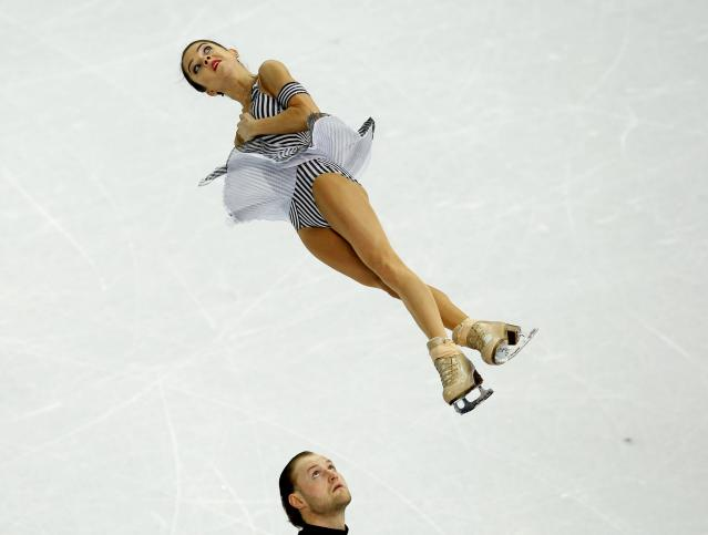 Russia's Vera Bazarova (top) and Yuri Larionov compete during the figure skating pairs short program at the Sochi 2014 Winter Olympics, February 11, 2014. REUTERS/Brian Snyder (RUSSIA - Tags: SPORT FIGURE SKATING OLYMPICS TPX IMAGES OF THE DAY)
