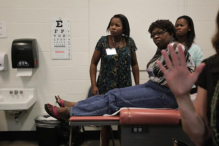 Nurses from Haiti attend a training program at Regis College. (PHOTO: Suzanne Kreiter/The Boston Globe via Getty Images)