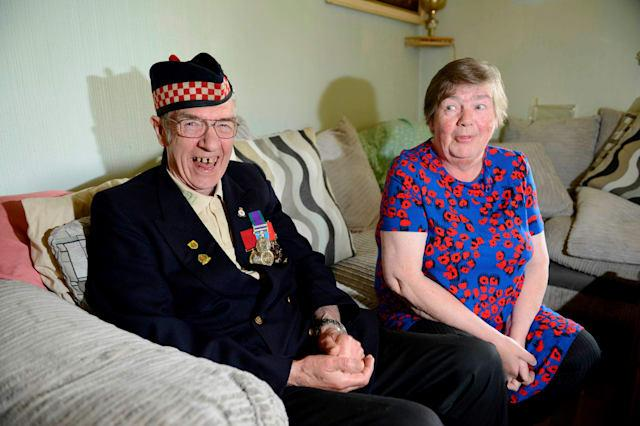 Former soldier Geordie and wife Betty Rhodick, from Lochgilphead, Argyllshire, Scotland, June 9, 2015, celebrating winning £1m on the lottery after wife Betty found the winning ticket in the bin. See SWNS story SWLOTTO; A couple have become millionaires after rescuing a winning lottery ticket - from a BIN. Former soldier Geordie Rhodick, 71, threw his Euromillions ticket in the waste after a quick check of his numbers revealed he had won nothing in the main draw. But his wife Betty, 63, fished it out and took it to their local shop - to be told they had struck it lucky in the Millionaire Maker raffle. After discovering he had landed a seven-figure windfall, the army veteran had no thoughts of immediately spending his fortune.
