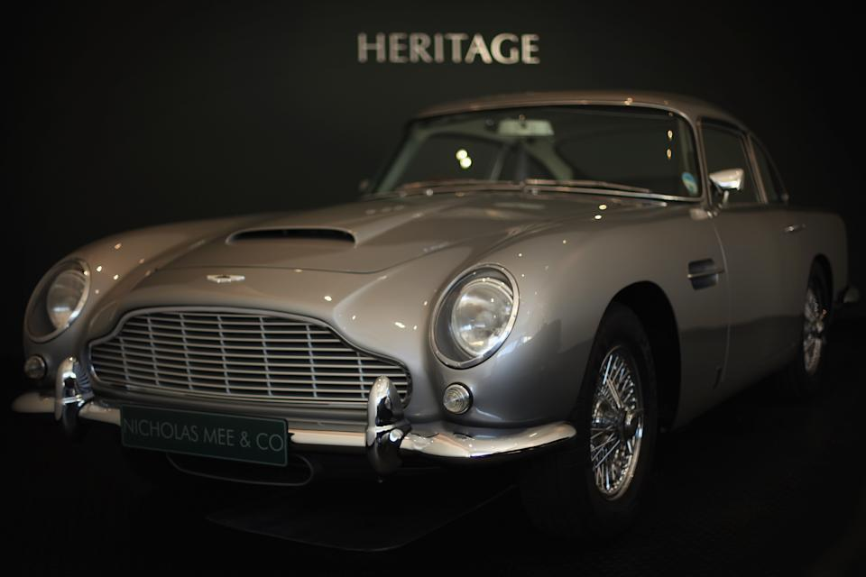 LONDON, ENGLAND - FEBRUARY 01:  An Aston Martin DB5 sits in the new 'Heritage' Showroom' in Hammersmith on February 1, 2012 in London, England. The showroom is the UK's first high street 'Heritage' showroom specialising in vintage and classic Aston Martin cars, and opens to the public on February 2, 2012.  (Photo by Dan Kitwood/Getty Images)