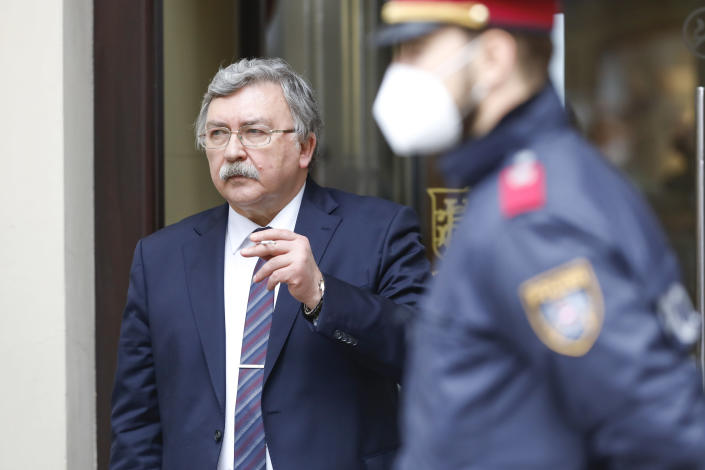 Russia's Governor to the International Atomic Energy Agency (IAEA), Mikhail Ulyanov, has a cigarette break outside of the 'Grand Hotel Wien' where closed-door nuclear talks with Iran take place in Vienna, Austria, Friday, May 7, 2021. (AP Photo/Lisa Leutner)