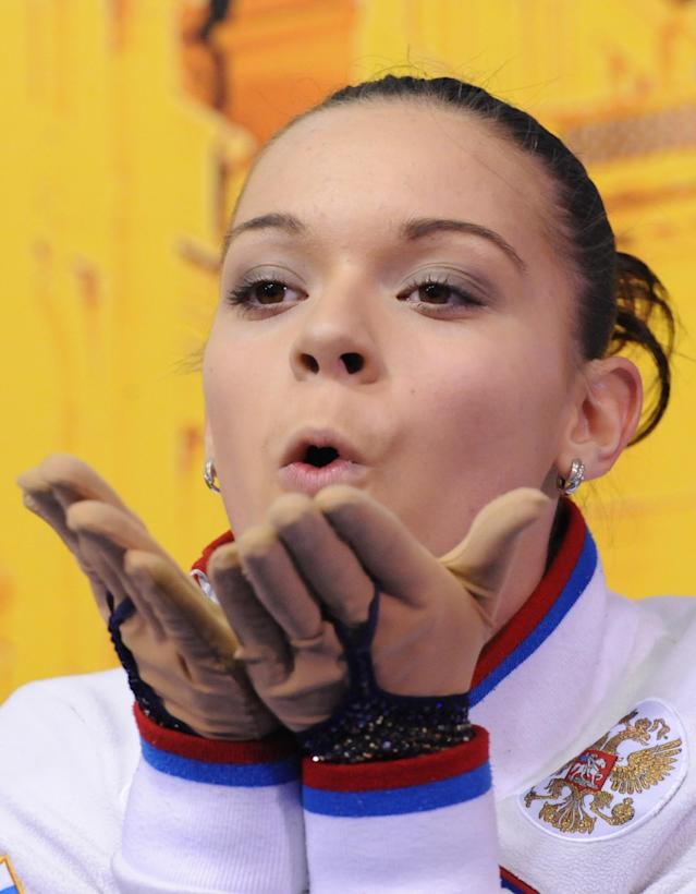 Russian Adelina Sotnikova blows kisses as she waits for her points in the Dom Sportova sports hall in Zagreb on January 26, 2013 during the women's free skating event at the ISU European Figure Skating Championships. AFP PHOTO / ATTILA KISBENEDEKATTILA KISBENEDEK/AFP/Getty Images