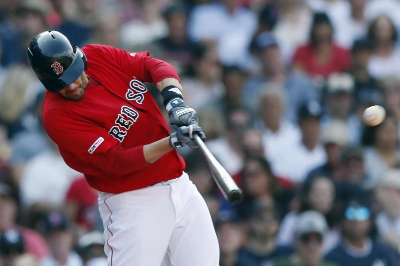 Boston Red Sox's J.D. Martinez hits a two-run home run during the fourth inning of a baseball game against the New York Yankees in Boston, Saturday, July 27, 2019. (AP Photo/Michael Dwyer)