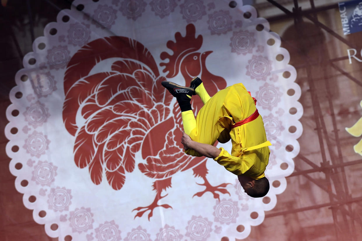 An artist performs during the Lunar parade through the center of Rome to mark Chinese new year, in Rome, Saturday, Jan. 28, 2017. (AP Photo/Alessandra Tarantino)