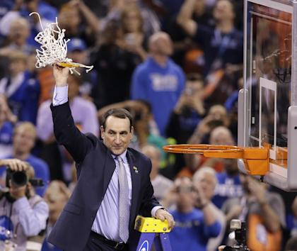 Duke head coach Mike Krzyzewski holds up the net after his team's national title game win. (AP)