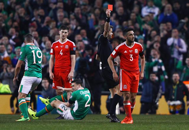 <p>Wales' Neil Taylor is sent off after his X-rated challenge which broke Seamus Coleman's leg </p>