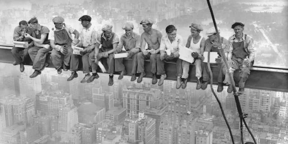 Intrepid steel workers atop the 70 story RCA building in Rockefeller Center get all the air and freedom they want by lunching on a steel beam with a sheer drop of over 800 feet to the street level. Image taken on September 20, 1932. <br>