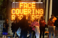A sign encourages visitors to wear face masks amid the COVID-19 pandemic Friday, Feb. 19, 2021, in Santa Monica, Calif. (AP Photo/Marcio Jose Sanchez)