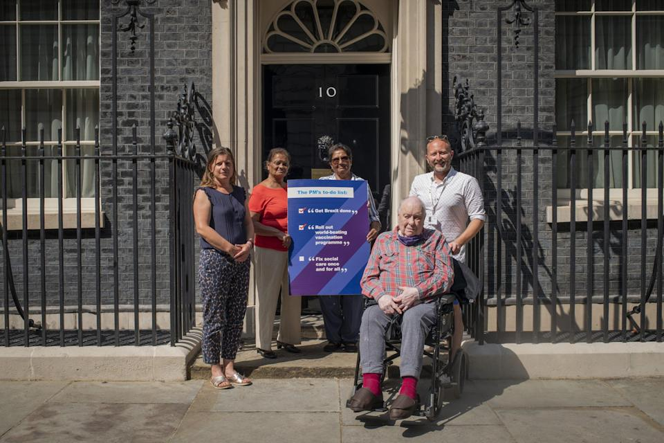 Campaigners handing in an Age UK Social Care petition and letter at 10 Downing Street (Jamie Lau/Age UK) (PA Media)