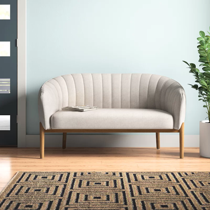 """<h3><strong>AllModern</strong></h3> <br><br><strong>Best For: MCM-Style Furniture<br></strong>Blame the lasting effects of <em>Mad Men</em>: The mid-century modern look isn't going anywhere soon. And we're not mad about it — the sleek shapes and retro silhouettes can make a sparsely decorated room look like minimalist cool instead of depressing. But the perfect pieces to add to your collection can easily run into four figures and beyond. Enter AllModern, where you can nab a Don Draper-approved piece for up to 55% off every day. We especially love the wide variety of couches available for under $500.<br><br><strong><em><a href=""""https://www.allmodern.com/"""" rel=""""nofollow noopener"""" target=""""_blank"""" data-ylk=""""slk:Shop AllModern"""" class=""""link rapid-noclick-resp"""">Shop AllModern</a></em></strong><br><br><strong>AllModern</strong> Bustillos 55"""" Flared Arm Loveseat, $, available at <a href=""""https://go.skimresources.com/?id=30283X879131&url=https%3A%2F%2Fwww.allmodern.com%2Ffurniture%2Fpdp%2Fbustillos-55-flared-arm-loveseat-a001052508.html"""" rel=""""nofollow noopener"""" target=""""_blank"""" data-ylk=""""slk:AllModern"""" class=""""link rapid-noclick-resp"""">AllModern</a><br><br><br><br>"""