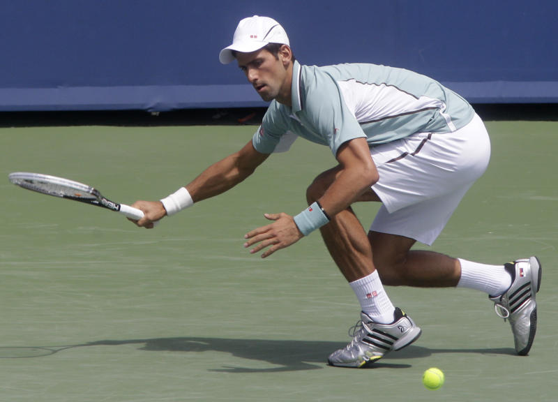 Novak Djokovic, from Serbia, runs down a ball against John Isner during a quarterfinal match at the Western & Southern Open tennis tournament, Friday, Aug. 16, 2013, in Mason, Ohio. (AP Photo/Al Behrman)