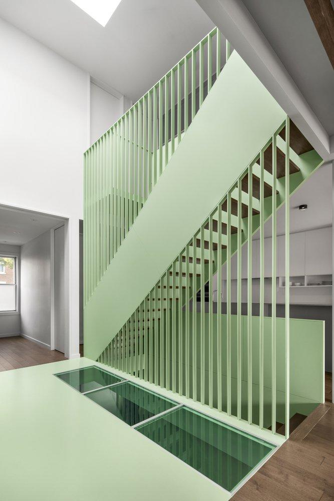 A lovely mint green staircase sits at the heart of the renovated Victoria Residence.