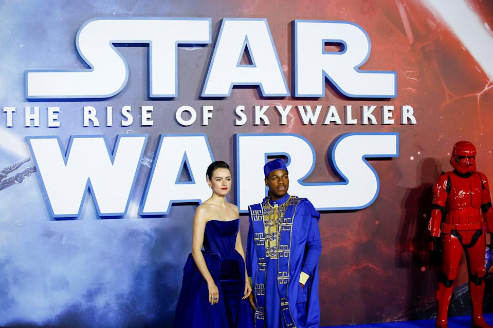 "Cast members Daisy Ridley and John Boyega pose as they attend the premiere of ""Star Wars: The Rise of Skywalker"" in London, Britain, December 18, 2019. REUTERS/Henry Nicholls"