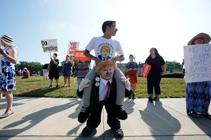 Protestors gather around a baby Trump balloon to voice their rally against gun violence and a visit from U.S. President Donald Trump following a mass shooting in Dayton, Ohio, Aug. 7, 2019. (Photo: Bryan Woolston/Reuters)