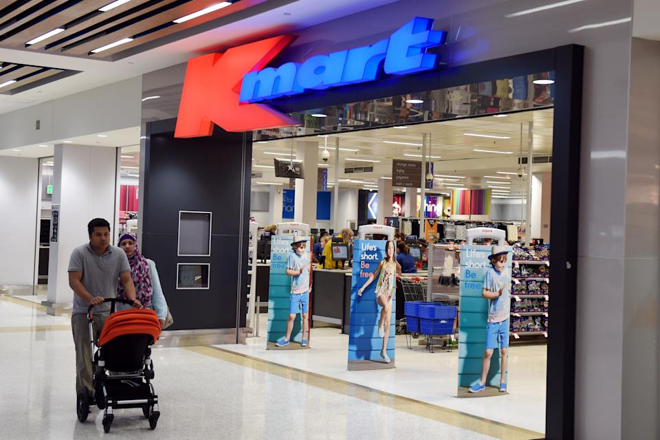 Shoppers leaving a Kmart store in Sydney.