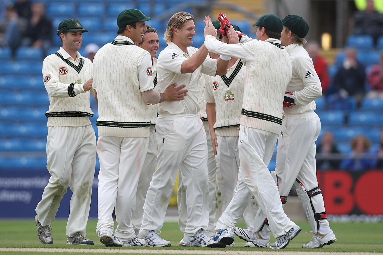 LEEDS, ENGLAND - JULY 22:  Shane Watson of Australia celebrates his fifth wicket of the innings that of Umar Gul of Pakistan with team mates during day two of the 2nd Test between Pakistan and Australia played at Headingley Carnegie Stadium on July 22, 2010 in Leeds, England.  (Photo by Hamish Blair/Getty Images)