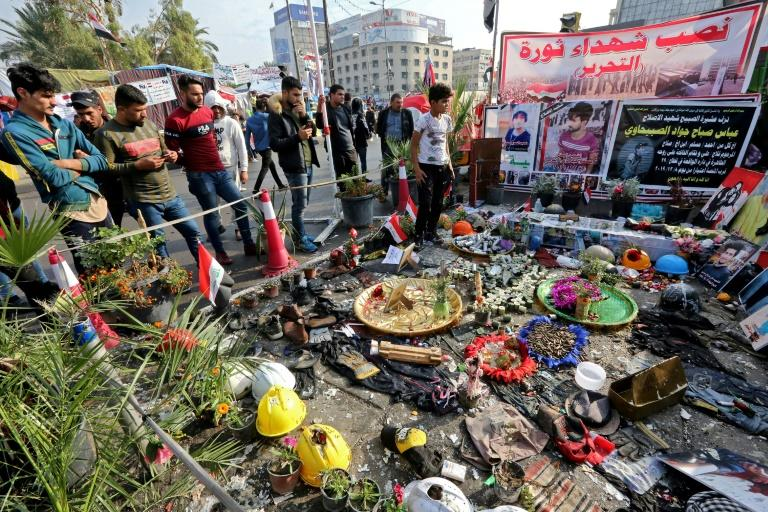 After an attack by unidentified gunmen on Iraqi protesters left 24 dead, demonstrators in Tahrir Square created a memorial to the slain