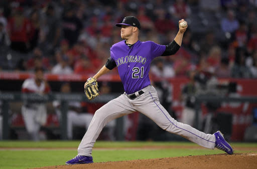"<a class=""link rapid-noclick-resp"" href=""/mlb/teams/col"" data-ylk=""slk:Colorado Rockies"">Colorado Rockies</a> starting pitcher <a class=""link rapid-noclick-resp"" href=""/mlb/players/9863/"" data-ylk=""slk:Kyle Freeland"">Kyle Freeland</a> throws to the plate during the first inning of a baseball game against the <a class=""link rapid-noclick-resp"" href=""/mlb/teams/laa"" data-ylk=""slk:Los Angeles Angels"">Los Angeles Angels</a>. (AP)"