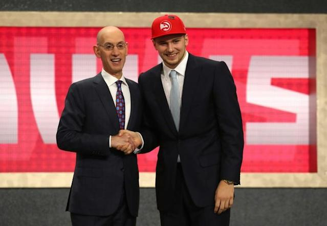 Luka Doncic (R) is congratulated by NBA Commissioner Adam Silver after being drafted third overall by the Atlanta Hawks during the 2018 NBA Draft, at the Barclays Center in New York, on June 21