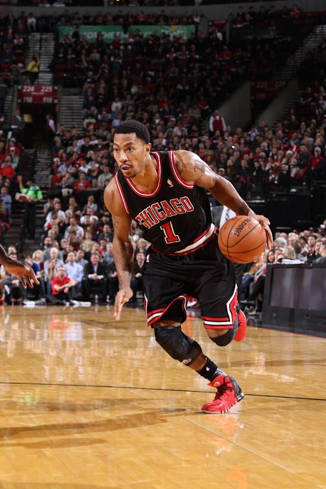 PORTLAND, OR - NOVEMBER 22: Derrick Rose #1 of the Chicago Bulls drives to the basket against the Portland Trail Blazers on November 22, 2013 at the Moda Center Arena in Portland, Oregon. (Photo by Sam Forencich/NBAE via Getty Images)