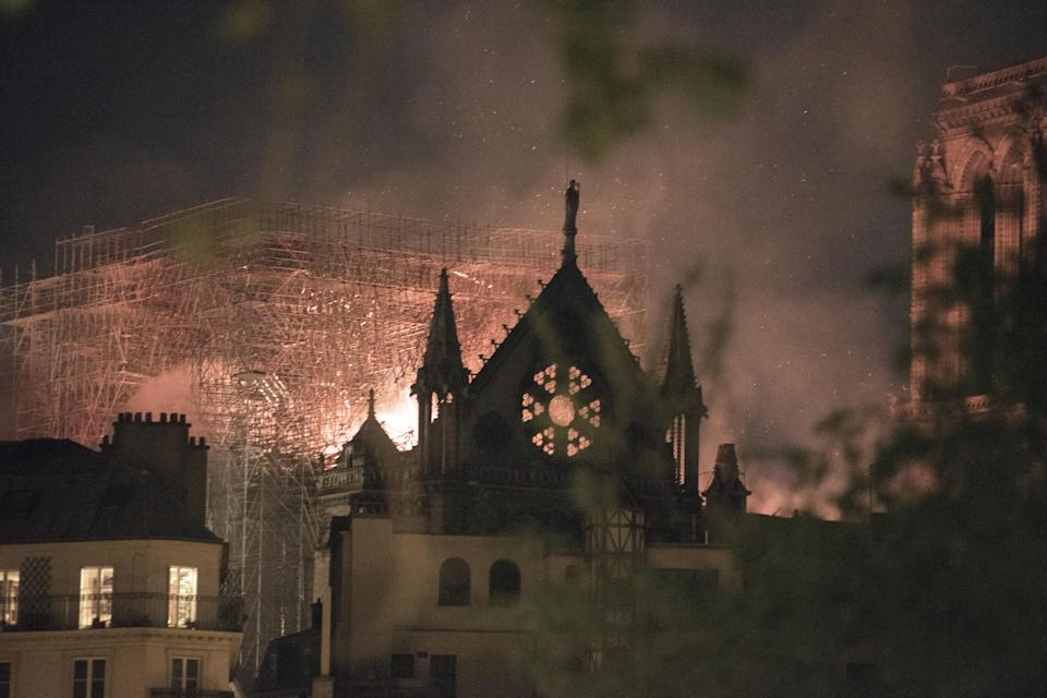 Flames and smoke rise from a fire at the Notre Dame Cathedral. Source: Getty
