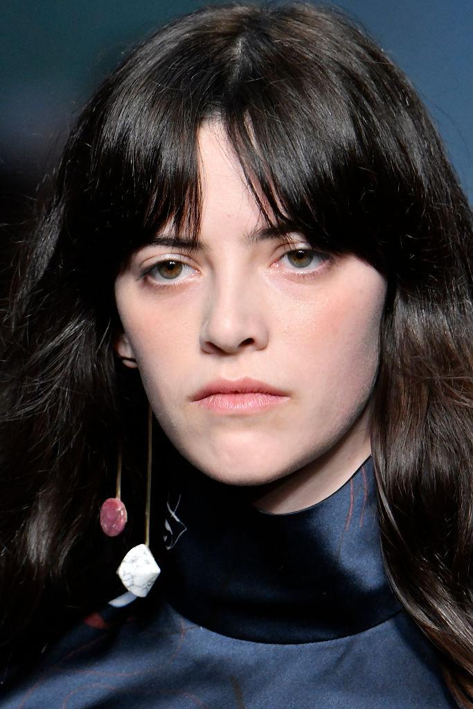 <p>Red and white marble monocle earring at the Roksanda FW18 show. (Photo: Getty) </p>