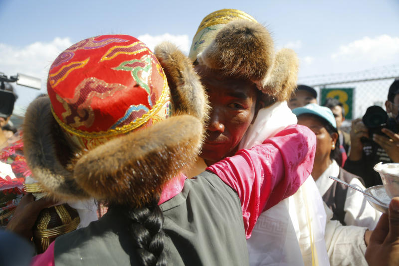 Nepalese veteran Sherpa guide Kami Rita, 49, is welcomed by his sister at the airport in Kathmandu, Nepal, Saturday, May 25, 2019. The Sherpa mountaineer extended his record for successful climbs of Mount Everest with his 24th ascent of the world's highest peak on Tuesday. (AP Photo/Niranjan Shrestha)