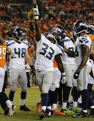 Christine Michael points to the sky after scoring in Thursday's preseason opener (AP)