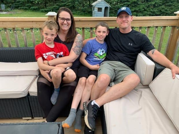 Donovan and Jenn McNeely went public this month with social media posts about the arduous hemophilia treatment their sons Declan, 9, and Tristan, 6, must endure, even though a simpler drug has been approved by Health Canada. (Laura Meader/CBC - image credit)