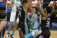 Sacramento Kings guard Cory Joseph (9) fouls Charlotte Hornets guard LaMelo Ball (2) during the first quarter of an NBA basketball game in Sacramento, Calif., Sunday, Feb. 28, 2021. (AP Photo/Randall Benton)