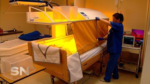 The hyperthermia treatment takes place in a temperature-controlled tent.