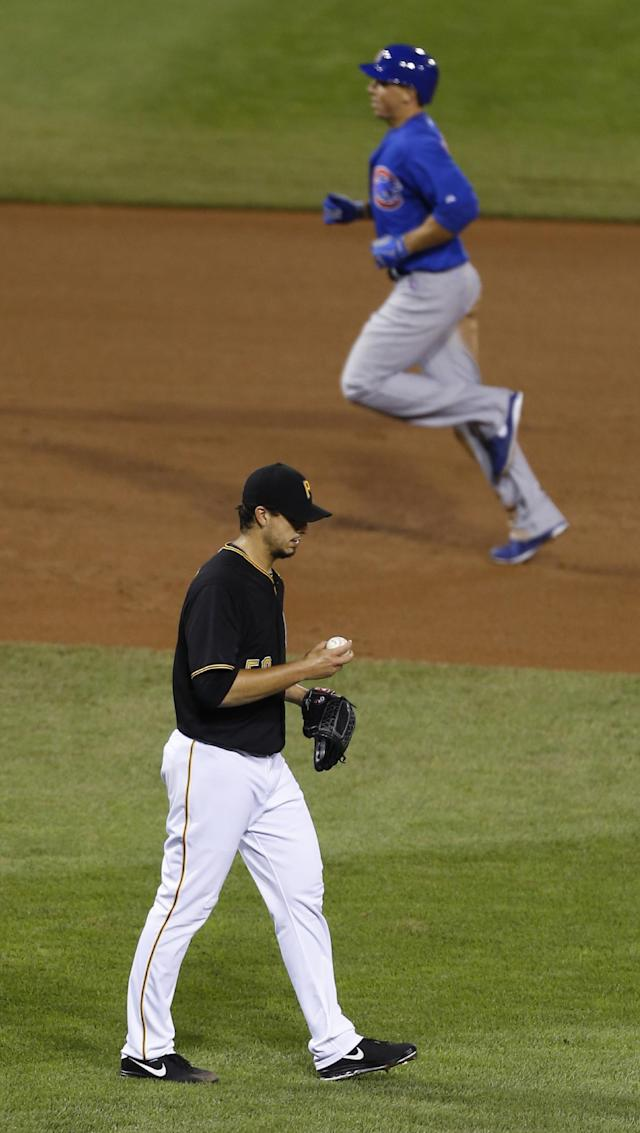 Chicago Cubs' Brian Bogusevic, top, rounds the bases behind Pittsburgh Pirates starting pitcher Charlie Morton after hitting a two-run home run in the fourth inning of a baseball game on Friday, Sept. 13, 2013, in Pittsburgh. (AP Photo/Keith Srakocic)