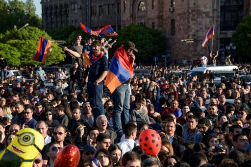 Armenians celebrate Serzh Sarkisian's resignation as premier in downtown Yerevan on April 23, 2018 following mass protests against his switch to the newly-empowered role of prime minister after his second and last term as president expired