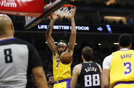 James has a triple-double, Lakers throttle Kings""