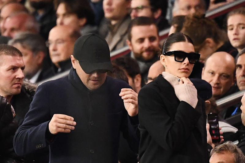 Camila Morrone and Leonardo DiCaprio are a sight for sore eyes as they make their way through a crown in all-black outfits